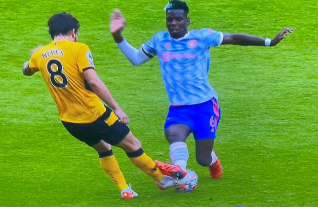 Paul Pogba was fortunate to escape a booking for his tackle on Ruben Neves