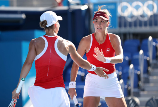 Belinda Bencic of Team Switzerland and Viktorija Golubic of Team Switzerland celebrate after a point during their Women's Doubles Gold Medal match against Barbora Krejcikova of Team Czech Republic and Katerina Siniakova of Team Czech Republic on day nine of the Tokyo 2020 Olympic Games at Ariake Tennis Park on August 01, 2021 in Tokyo, Japan.