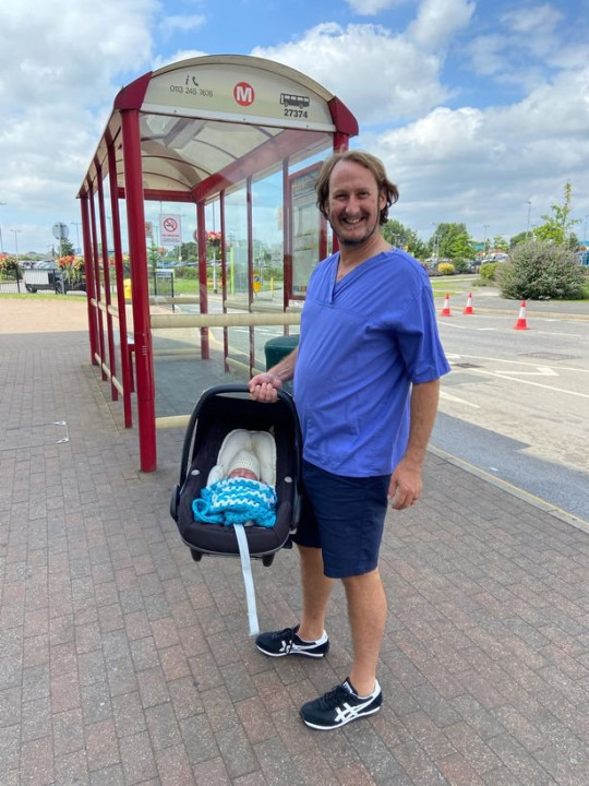 Dad Philip and Barnaby at the bus stop where he was born