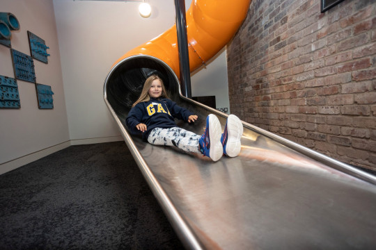 a young girl using the slide at Pattern Church