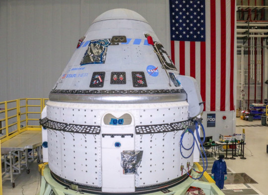 Undated handout photo issued by NASA of the Boeing CST-100 Starliner spacecraft at the Kennedy Space Center in Florida. Aerospace giant Boeing is set to attempt its second uncrewed flight to the International Space Station (ISS) as part of a test to show it can get to and from the orbiting lab safely. Issue date: Monday July 26, 2021. PA Photo. See PA story SCIENCE Starliner. Photo credit should read: Boeing/PA Wire NOTE TO EDITORS: This handout photo may only be used in for editorial reporting purposes for the contemporaneous illustration of events, things or the people in the image or facts mentioned in the caption. Reuse of the picture may require further permission from the copyright holder.