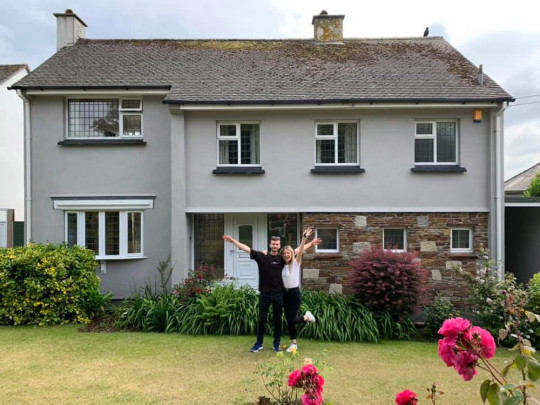 Kate and Ryan after getting the keys to their first home. (PA Real Life/Collect)