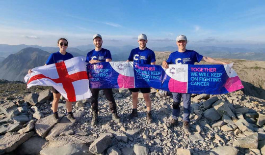 Ryan and his friends at the top of Scafell Pike in the Lake District, England. (PA Real Life/Collect)