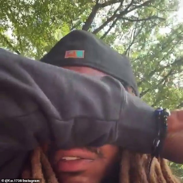 Trying to hold it together: Fetty Wap wipes his eyes as he talks about his daughter, Lauren, who died at just four years old this week.