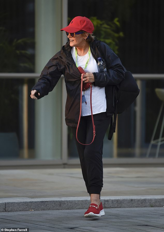 Keeping warm:TV veteran Anne opted for black trousers and a black raincoat, beneath which she wore a crisp white T-shirt