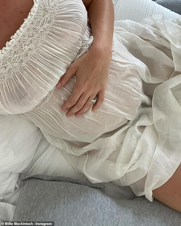 Happy: She went on to explain that she was finding pregnancy during the summer 'easier' as she can wear comfortable dresses instead of putting together winter outfits