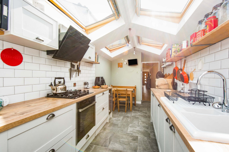 A tiny two-bedroom terraced home measuring just 2.4 meters in width for sale in London