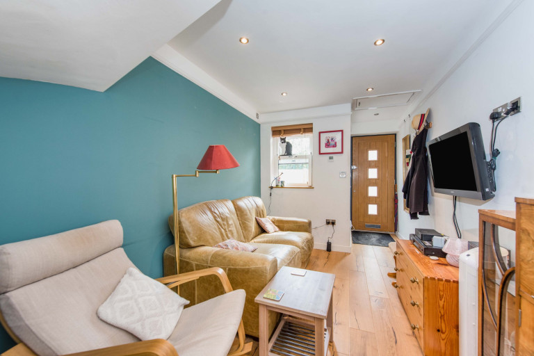 A tiny two-bedroom terraced home measuring just 2.4 meters in width for sale in London - living room