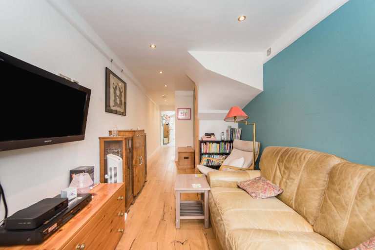 A tiny two-bedroom terraced home measuring just 2.4 meters in width for sale in London.