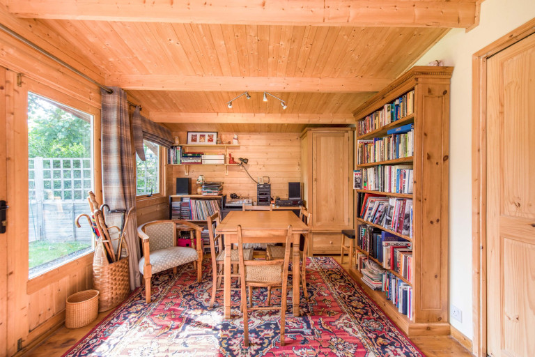A tiny two-bedroom terraced home measuring just 2.4 meters in width for sale in London - living area in annex outbuilding