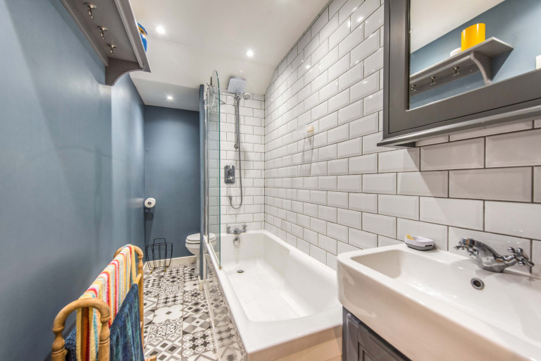 A tiny two-bedroom terraced home measuring just 2.4 meters in width for sale in London - bathroom