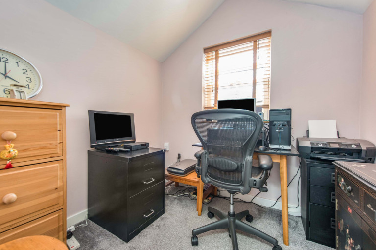 A tiny two-bedroom terraced home measuring just 2.4 meters in width for sale in London - home office in second bedroom