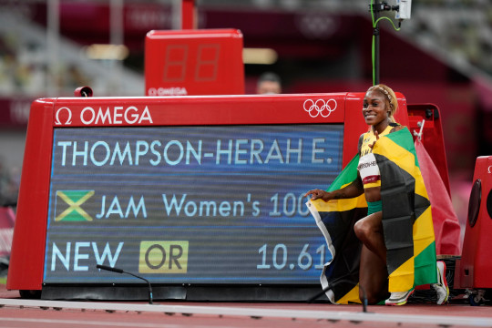Elaine Thompson-Herah of Jamaica wins the 100 metres gold at the Tokyo Olympics