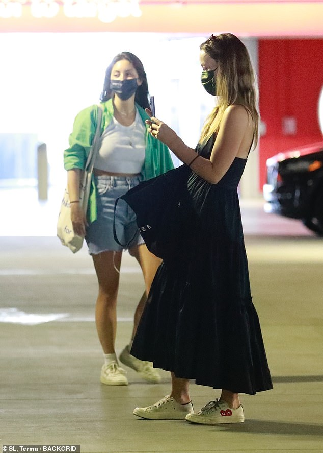 Chic:The actress, 37, teased a glimpse of her cleavage as she strolled into the parking lot with a trolley-full of essentials