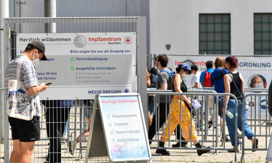 People line up at a vaccination centre in Dresden