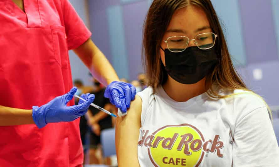 A nurse administers a first jab to a 15-year-old girl at a vaccination centre in Gran Canaria