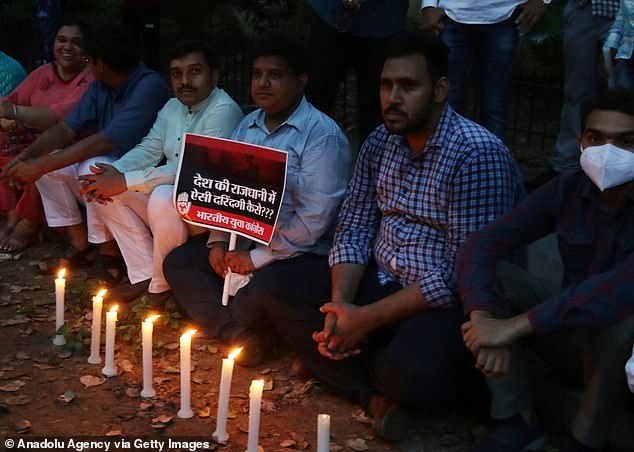 Activists of the Bheem Army stage a candle march protest against alleged rape and murder of a nine-year-old girl