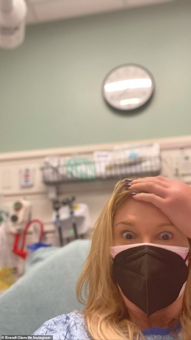 Not a happy day for Brandi: The TV star put one hand to her forehead as she looked surprised to be in the hospital