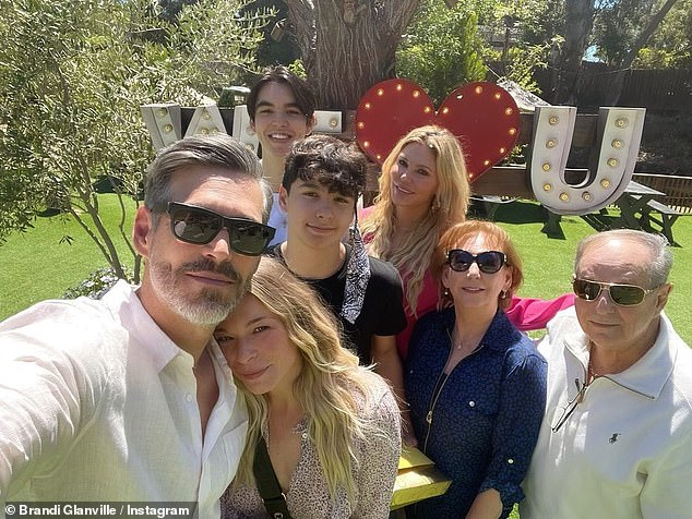 'I think our kids had a lot to do with it because the kids love when we're all together, and it's so obvious. They're so happy,' the reality star explained of how co-parenting her two sons Jake, 14, and Mason, 18, with her ex Eddie Cibrian, 48, and Rimes, 38, brought them all together