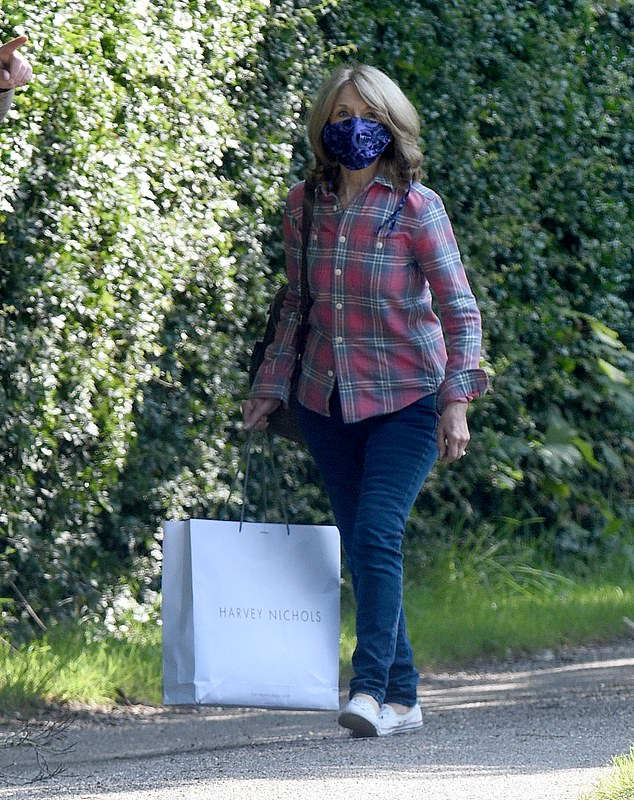 Arrival:Arriving for a day of filming in jeans and a plaid shirt, Helen was sporting a face mask and carrying a large shopping bag before getting into character