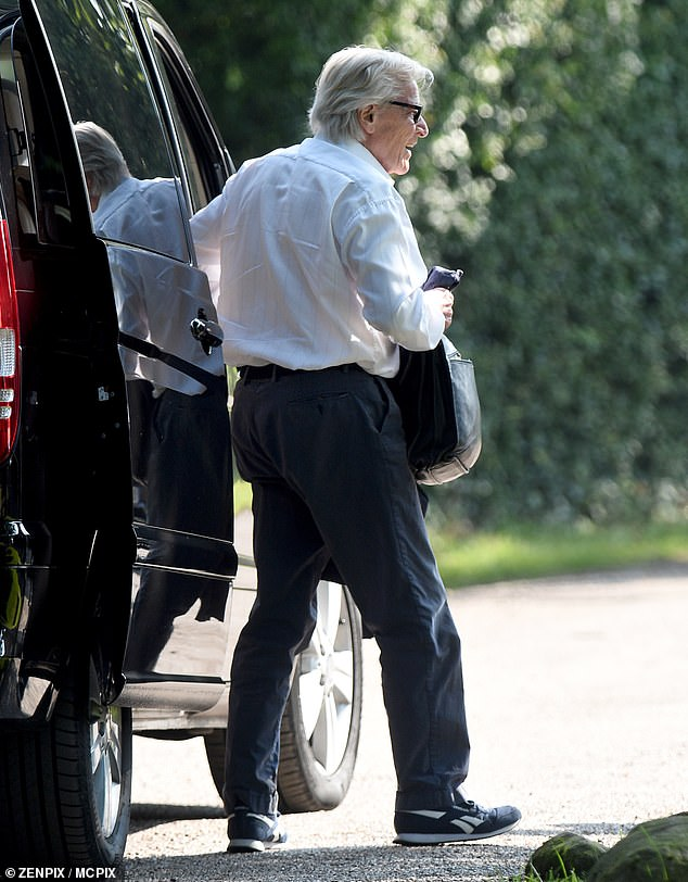 Change of outfit: When actorBill Roache arrived on the Manchester set he was wearing casual trousers and trainers