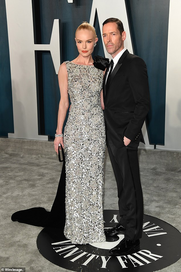 Still 'enamored': After several paragraphs reflecting on romance, Kate wrote: 'Our hearts are full, as we have never been so enamored and deeply grateful for one another as we do in this decision to separate.' They are seen during the 2020 Vanity Fair Oscar Party above