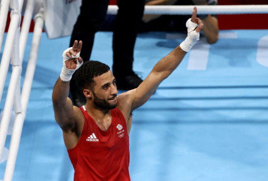 Galal Yafai celebrates his victory to secure a place in the flyweight final at Tokyo 2020