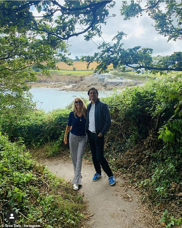 Family trip:The star also shared a sweet photo of her with husband Vernon Kay, 47, who stopped in their tracks to have a photo taken