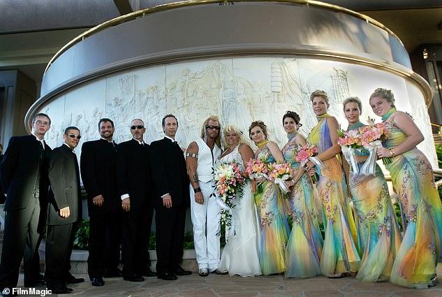 When he wed Beth: From left are Timothy Chapman, jr., Leland Chapman, Duane lee Chapman, Tim Cahpman, Boris Krutonog, Dog, Beth, Moon Angell, Maureen Krutonog, Carrie Chirstman, Lyssa Chapman, Cecily Chapman in 2006