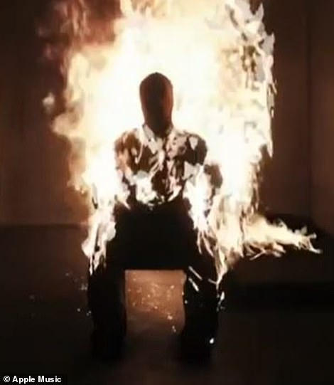 Up in flames: At one point he slipped on a protective suit and lit himself on fire