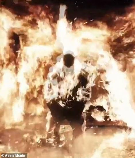 Wow: Kanye set himself on fire and calmly walked around the stage as he promoted his new music