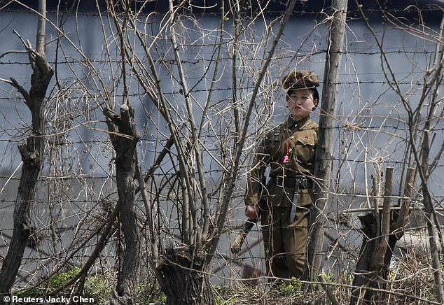 One account recorded from a former detainee alleges that North Korea beat her with a stick, chair and a leather belt. Pictured: Stock image of a North Korean prison guard