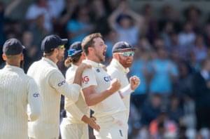 England's Ollie Robinson celebrates the wicket of India's Virat Kohli.