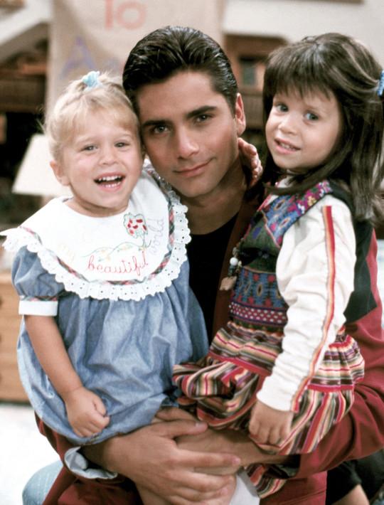 Ashley Olsen, John Stamos, Mary-Kate Olsen on Full House in 1989