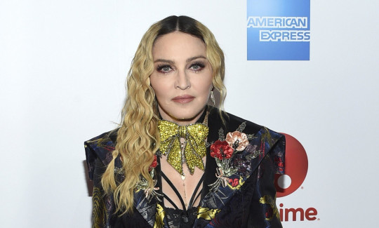 FILE - Madonna appears at the 11th annual Billboard Women in Music honors in New York on Dec. 9, 2016. Streaming service Paramount+ has landed a documentary that offers a glimpse into the personal life of Madonna and her work on the road.The streaming arm of ViacomCBS said Thursday that ???Madame X??? will make its debut in the U.S., Latin America, Australia, Nordic countries and Canada beginning Oct. 8. (Photo by Evan Agostini/Invision/AP, File)