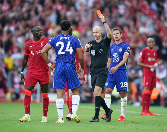 Chelsea's Reece James is shown a red card by referee Anthony Taylor during the Premier League match at Anfield, Liverpool