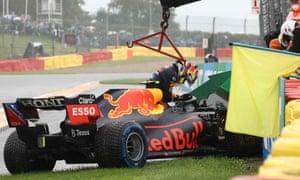 A despondent Sergio Perez exits his car.
