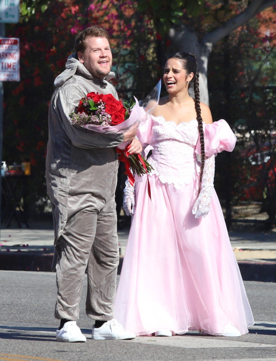 James Corden seems taking a smoke off random strangers joint between takes as he joins Camila Cabello and Billie Porter in street performance for new movie. 27 Aug 2021 Pictured: James Corden, Camila Cabello and Billie Porter. Photo credit: APEX / MEGA TheMegaAgency.com +1 888 505 6342