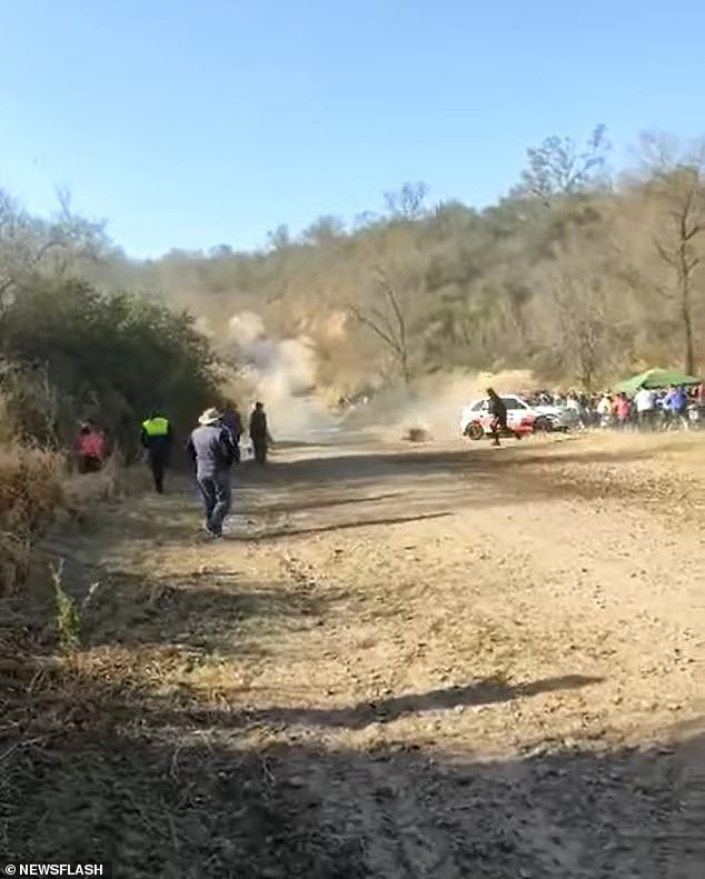 The car eventually flies off the track and ploughs directly into a large group of spectators who had been standing by the race track