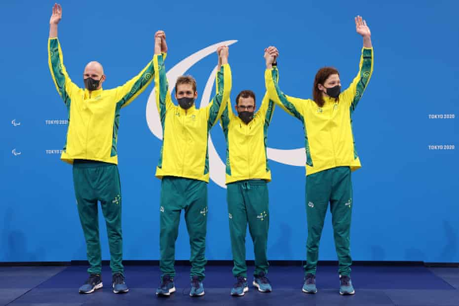 Gold medalists Rowan Crothers, William Martin, Matthew Levy and Ben Popham of Australia celebrate on the podium.