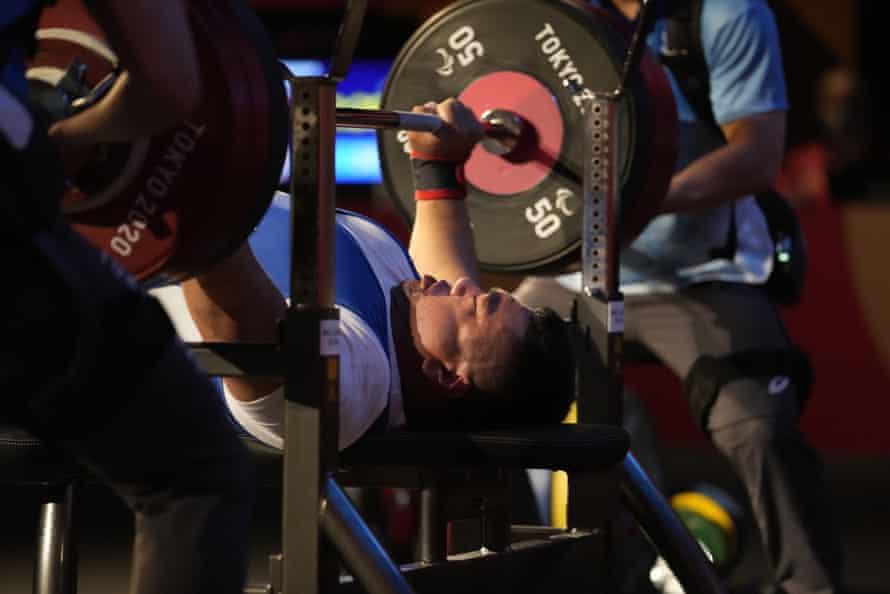 Mongolia's Sodnompiljee Enkhbayar competes during men's -107kg powerlifting final.