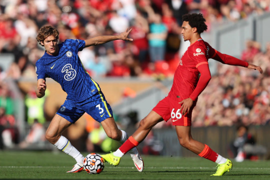 Ben Chilwell goes in for a challenge on Trent Alexander-Arnold during Chelsea's clash with Liverpool
