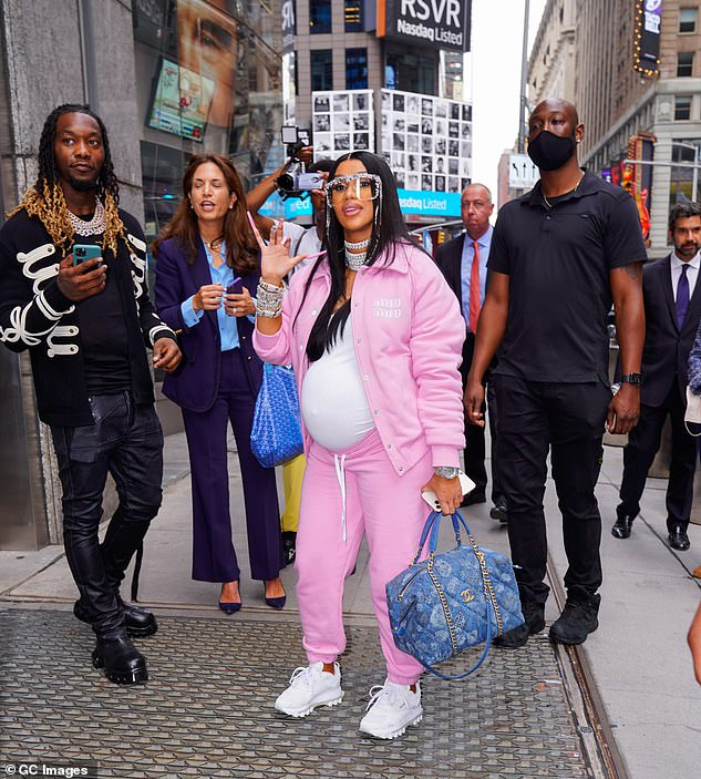 Money:The Rumors singer added extra bling with a pair of over-sized frames, and carried a blue denim Chanel bag by her side