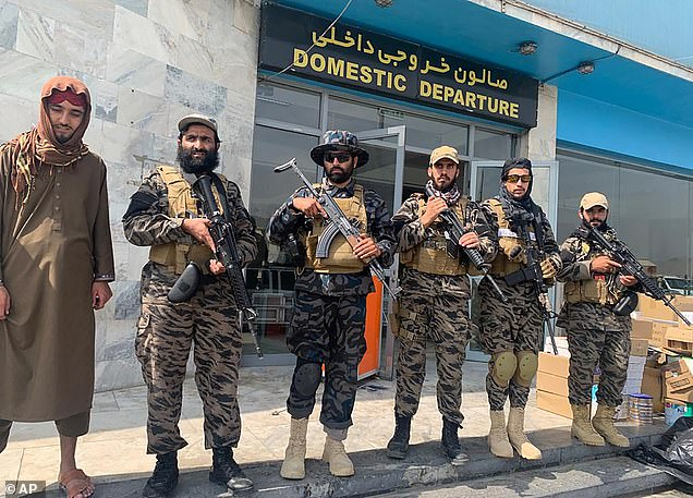 Taliban 'special forces' troops - known as Badri 313 units - stand guard at Kabul airport on Tuesday morning after retaking it from American forces overnight