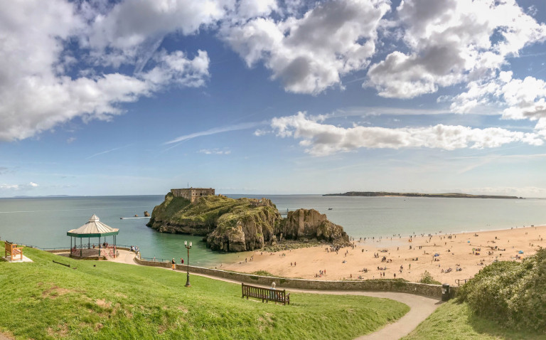 Best nature reserves Tenby, Pembrokeshire, Wales - August 2018: Wide angle view from the hill overlooking castle beach and St Catherine's Island in Tenby, West Wales.