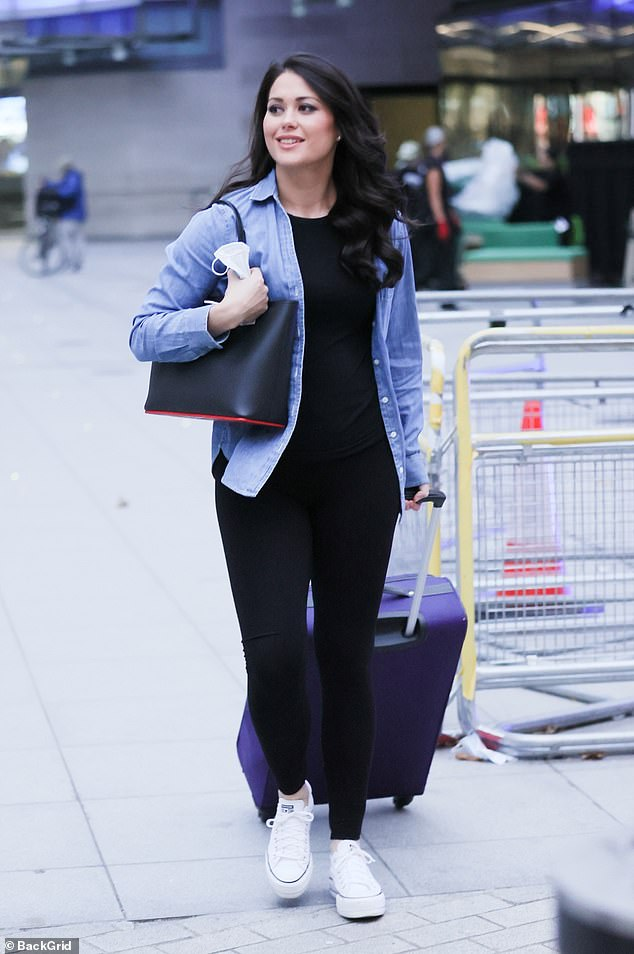 Stylish: Sam, 32, looked casually chic as she donned black leggings and a black top paired with a blue shirt