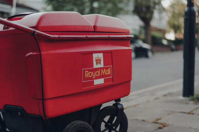 Red delivery trolley belonging to Royal Mail