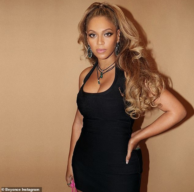 Shrugging it off:Beyonce shows off stunning physique in figure-hugging black dress... after being left 'disappointed and angry' over $30M Tiffany 'blood diamond'
