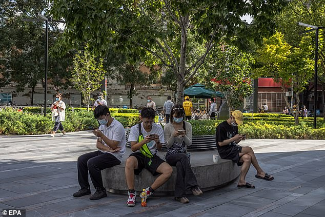 Children will be banned from playing mobile games for more than three hours a week under tough new regulations in China (file image)