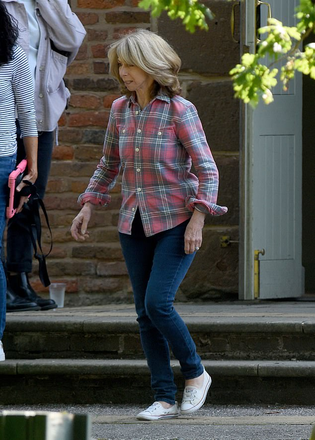 Speculation:Coronation Street stars Gail Platt, Ken Barlow and Claudia Colby were seen filming funeral scenes in Manchester on Wednesday, sparking speculation that Audrey Roberts has died